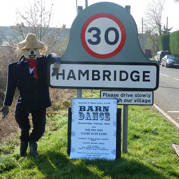 Hambridge village sign with scarecrow