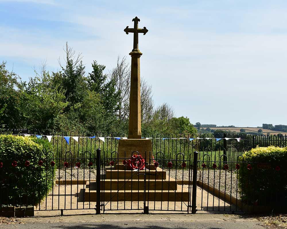 The memorial in Hambridge village with poppy wreath displays