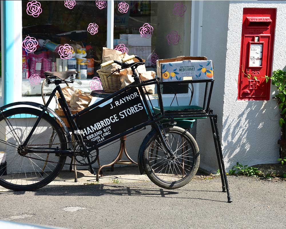 Hambridge Village Stores Vintage bicycle outside shop window